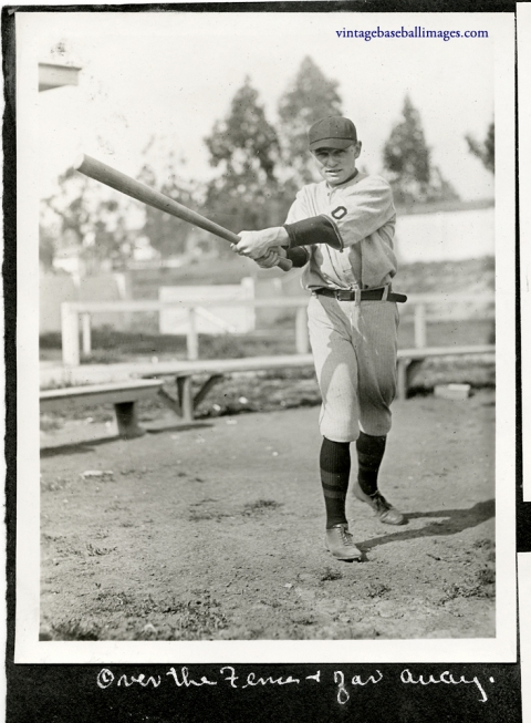 Vintage snapshot of an Occidental college baseball player swinging a bat, c 1922