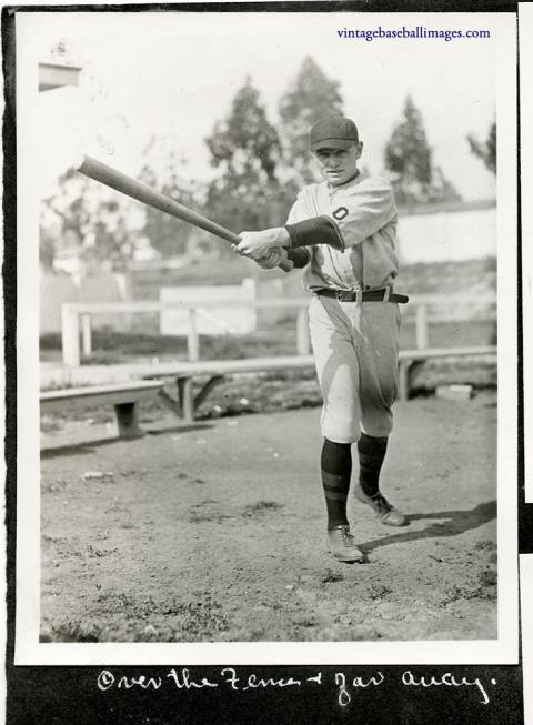 Vintage snapshot of an Occidental college baseball player swinging a bat, c 1922