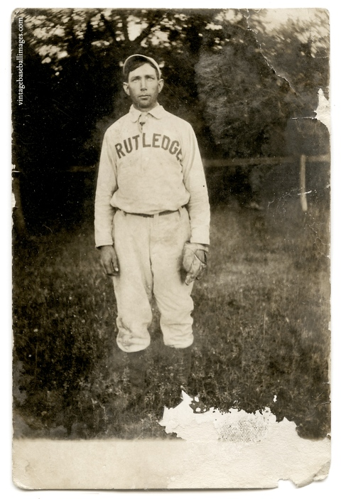 "Vintage snapshot of a handsome amateur baseball player wearing a ""Rutledge"" uniform after a game"