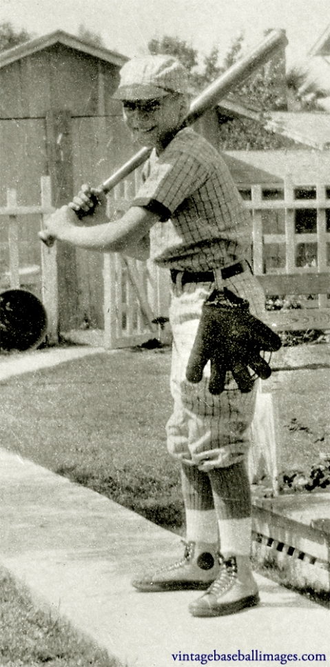 Close-up of boy in batting stance, showing the glove hanging from his hip