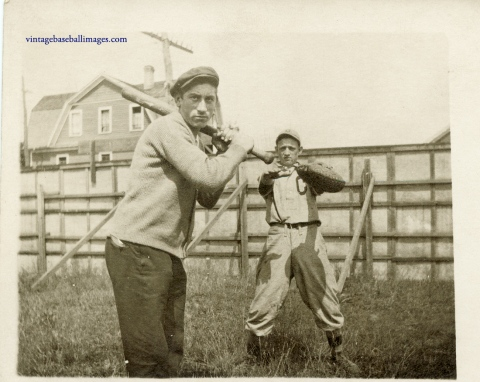 amateur baseball players pose as if hitting and catching in circa 1920s snapshot