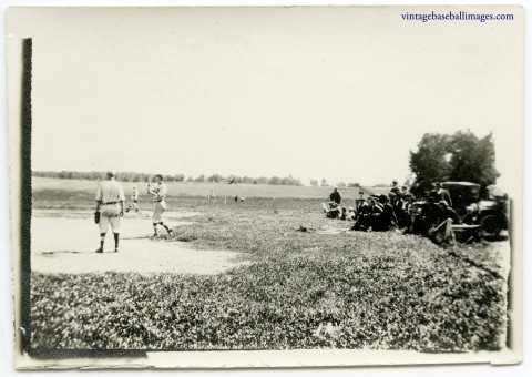 Vintage snapshot of a circa 1910s baseball game watched by a small crowd
